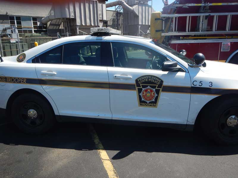 Patrons Allowed to Sit in Police Cruiser -- As Good Guys!